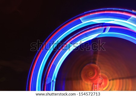 spinning wheel in a small luna park  - stock photo