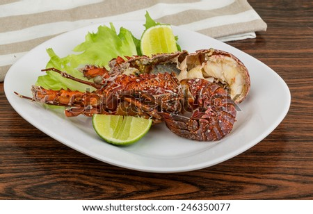 Spiny lobster grilled with lime and spices - stock photo