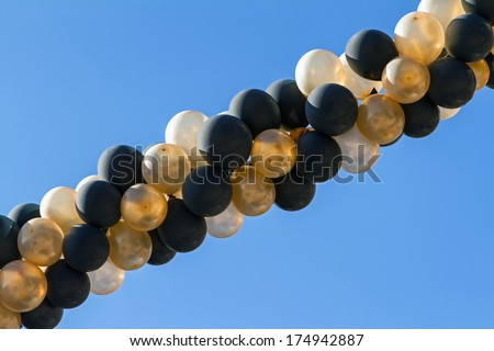 spiral chain of colored inflatable balloons - stock photo