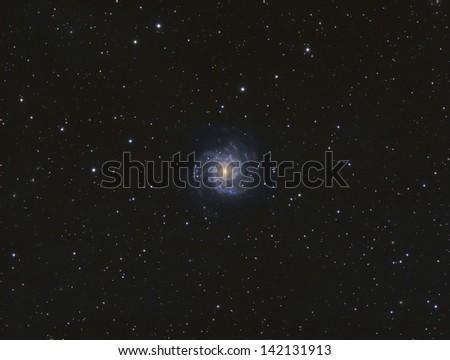 Spiral Galaxy Messier 74 - A face-on spiral galaxy about 32 million light years away in the constellation Pieces - stock photo