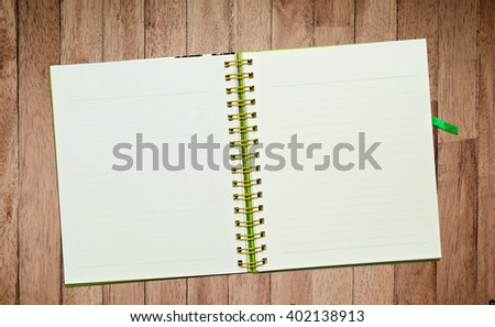 Spiral leather notebook on desk - stock photo