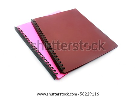 spiral lined pink and brown file isolated on white - stock photo