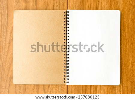 Spiral notebook on wood background - stock photo