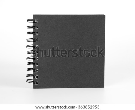 Spiral notebook with black cover on white - stock photo