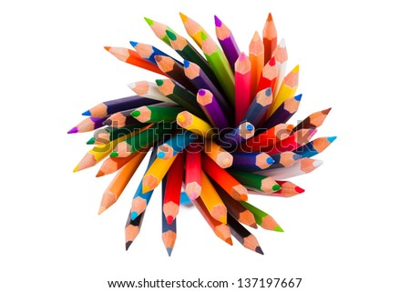 Spiral of color pencils on white background - stock photo