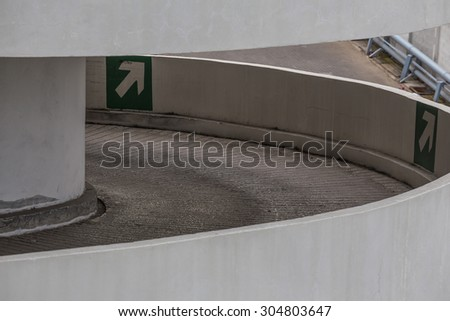 Spiral road to the mall garage. - stock photo