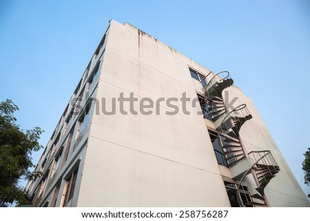 Spiral stair and old building - stock photo