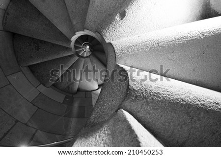 Spiral stair going up in black and white. Rotation of the outdoor staircase ascending up - stock photo