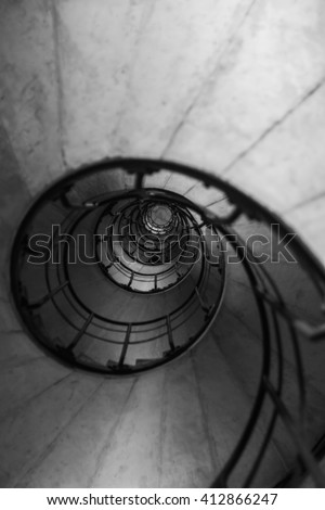 Spiral Stair inside the Arc De Triomphe in Paris in monotone image with blurred - stock photo