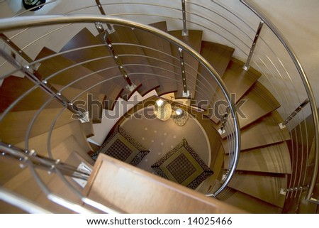 spiral staircase with two lamps - stock photo