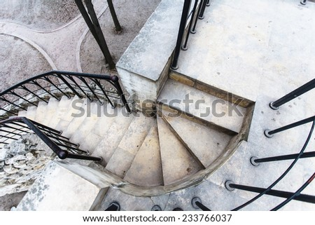 Spiral stone staircase top view - stock photo