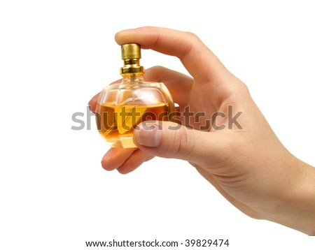 Spirits on a white background in a hand - stock photo