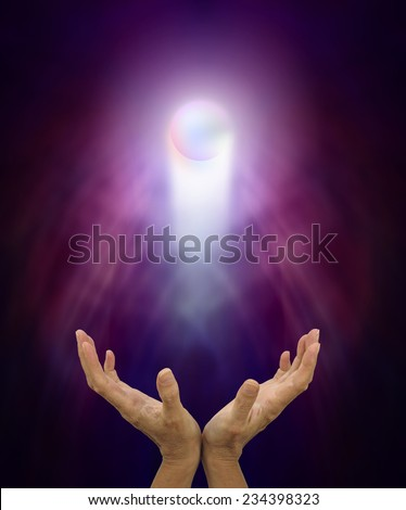 Spiritual Healing Orb  -   Healer's outstretched open hands with a glowing spirit orb rising up on a misty purple, blue and black background - stock photo