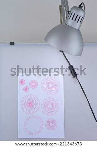 spirograph on sticker paper note on pvc board - stock photo