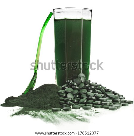 Spirulina  algae powder glass drink nutritional supplement close up , isolated on white background  - stock photo
