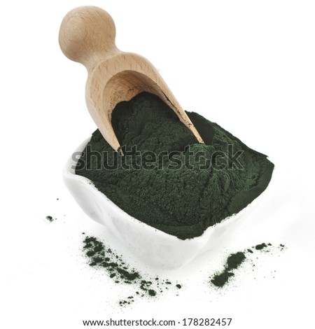 Spirulina powder - algae, nutritional supplement in spoon scoop isolated on white background  - stock photo