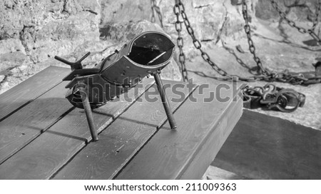 SPISSKY CASTLE, SLOVAKIA - JULY 19, 2014: The highboot for torture from oubliette the castle.  - stock photo