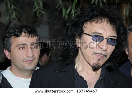 "SPITAK, ARMENIA - OCTOBER 1: Tony Iommi of Black Sabbath and one of his fans on October 1, 2009 in Spitak, Armenia. He visits Armenia within the framework of ""Armenia Grateful 2 Rock"" project. - stock photo"