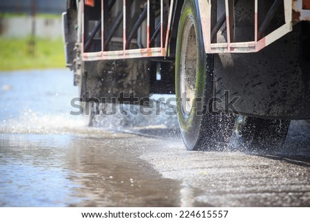 Splash by a truck as it goes through flood water - stock photo