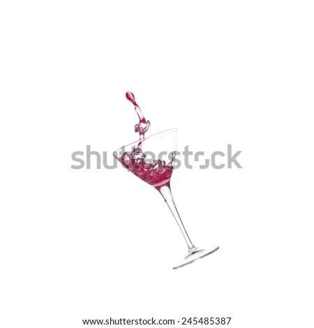 Splash cocktail with icecubes - stock photo