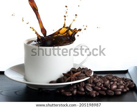 splash coffee isolated on white background - stock photo