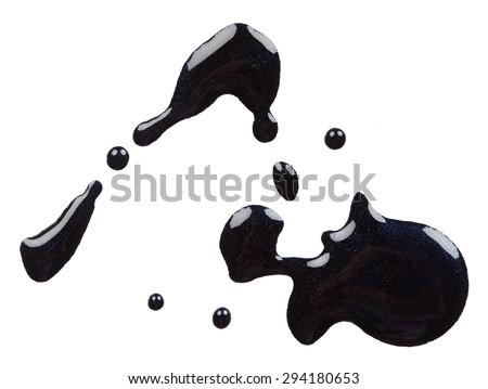Splash of black nail polish isolated on white background - stock photo