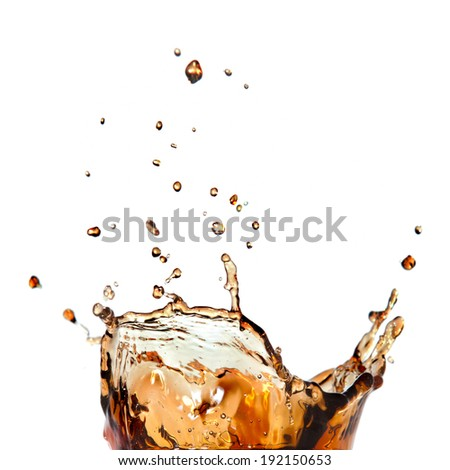 splash of cola in glass isolated on white background - stock photo