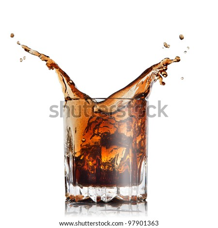 splash of cola in glass with ice cubes isolated on white - stock photo