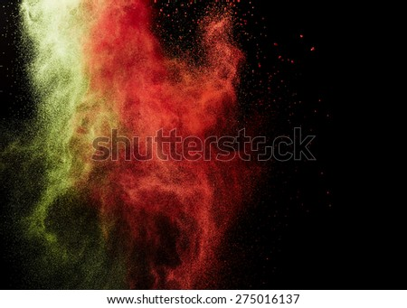 Splash of paint on black background - stock photo