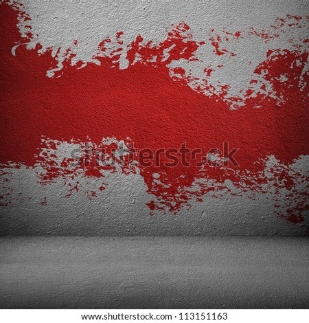 splash of red paint on the wall - stock photo