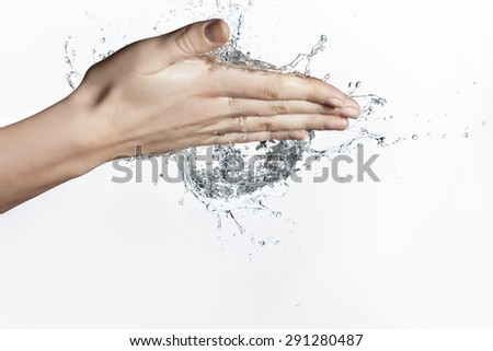 Splash of Water in Woman Hand - stock photo