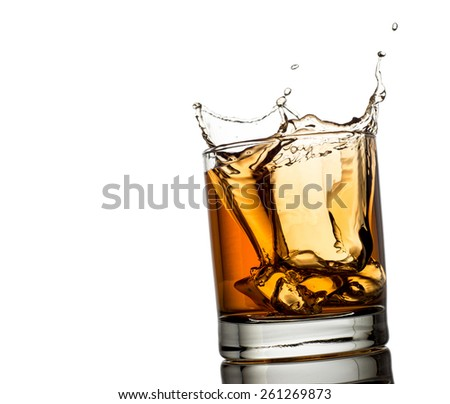 splash of whiskey with ice osolated on white  - stock photo