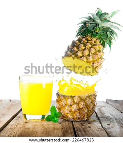 splash pineapple juice on wood - stock photo