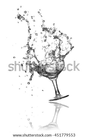 Splash water out of a glass on a white background.  - stock photo