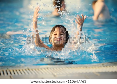 Splash water pool kid summer - stock photo