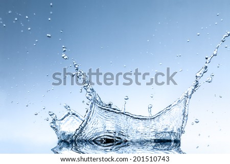 Splash water wave abstract over blue background - stock photo