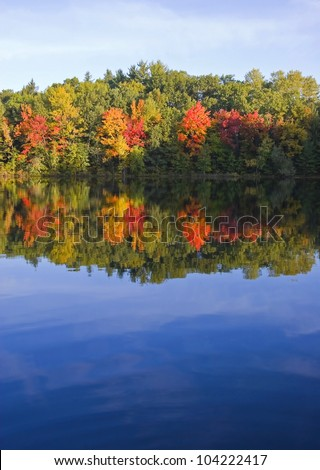 Splashes -- Blue Sky Reflection - Rockford, Michigan, USA. - stock photo