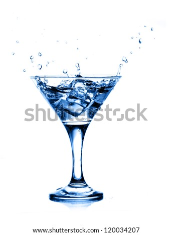 splashing into a martini isolated on white background - stock photo