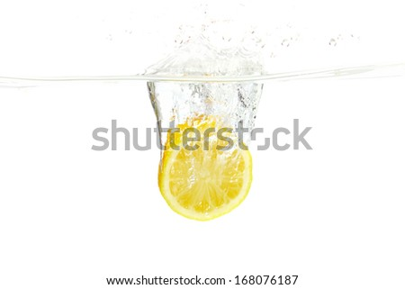 Splashing Lemon Slice - stock photo