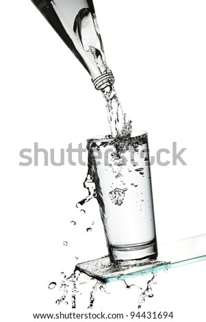 Splashing red liquid out of a bottle - stock photo