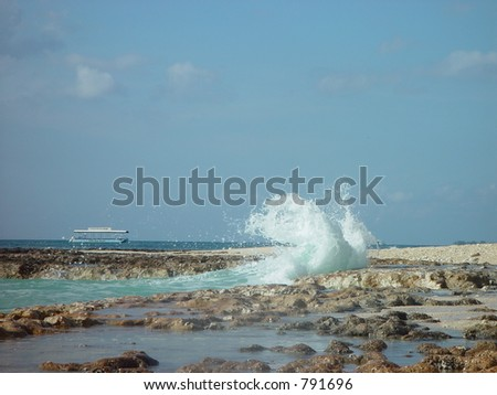 Splashing sea waves water waves on Seven Miles Beach - stock photo