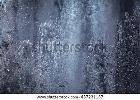 Splashing streams of fountains in Saint-Petersburg in Russia - stock photo