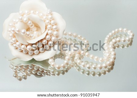 splendid necklace of white pearls with a porcelain vase - stock photo