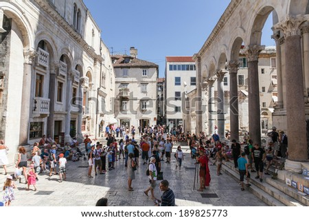 SPLIT, CROATIA - AUGUST 5, 2012: Tourists at the entrance of the Palace of Diocletian in the Historical Complex of Split, Croatia. The palace was built at the turn of the fourth century AD. - stock photo