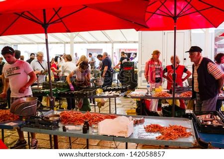 SPLIT, CROATIA - MAY 10, 2013: Busy day at Split's market. On 13 May 2013 in Dubrovnik, Croatia - stock photo