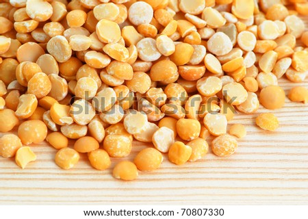 Split dried peas on a wooden background - stock photo