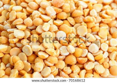 Split dried yellow peas background - stock photo
