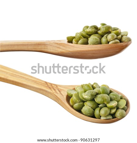 split peas  over spoon isolated on white - stock photo