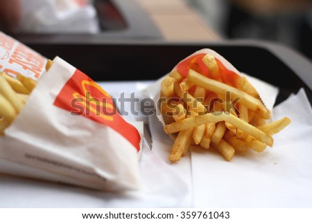 Split, ?roatia - February 26, 2015: Two portions of McDonald's french fries, one of the most popular fast food around the world. Selective focus.  - stock photo