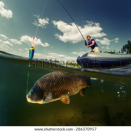 Split shot of the fisherman with rod in the boat and underwater view of the big fish (Carp of the family of Cyprinidae) - stock photo